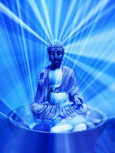 budda meditating with light radiating outwards